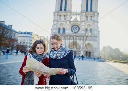 Two Young Girls Taking Selfie Near Notre-dame In Paris