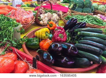 Fresh organically grown vegetables in market stall ready for sale at farmers market in France.