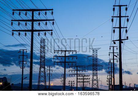 Pylons at twilight with lines in Bursa, Turkey