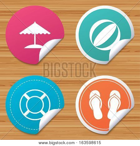 Round stickers or website banners. Beach holidays icons. Ball, umbrella and flip-flops sandals signs. Lifebuoy symbol. Circle badges with bended corner. Vector