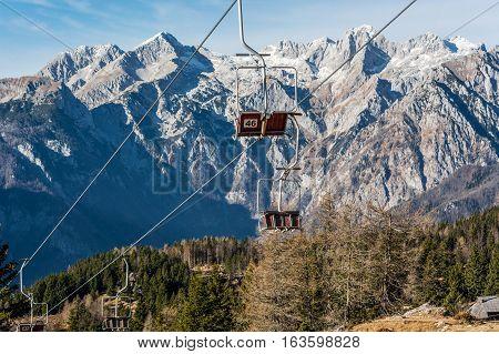 Empty ski lifts waiting for first snow. Autumn landscape at Velika planina, Slovenia.