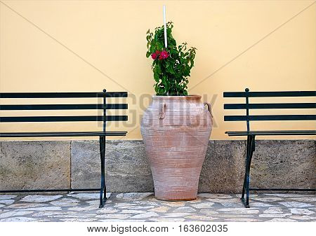 old Traditional Greek amphora and bench seating