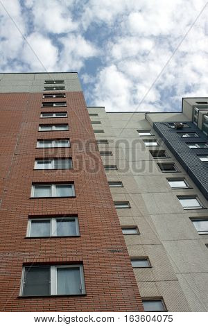 Modern apartment house wall, the view from the bottom up. vertical photo