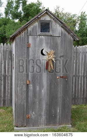 rustic outhouse by the fence, Westmoreland, Kansas historic area,