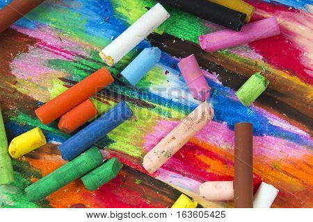 oil pastels crayons on colorful background, copy space