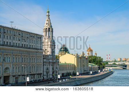 Moscow, Russia - June 20, 2010: Buildings on the other side of the Moskva River from the Kremlin with belltower of the Temple of God's St. Sofia Premudrosti