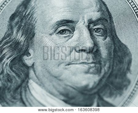 Dollars closeup. Benjamin Franklin's portrait on one hundred dollar bill