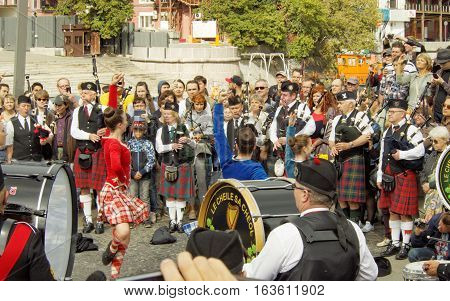 MOSCOW, RUSSIA - September 4, 2016: Dancing girls during show of Celtic pipes and drums band surrounded by townspeople in the Park on the Crimean embankment. Festival of military orchestras
