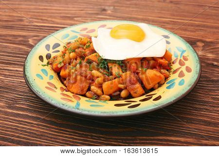 Sweet Potato Hash with Fresh Herbs, Peppers and Onions. Healthy eating concept. Nutritious breakfast.