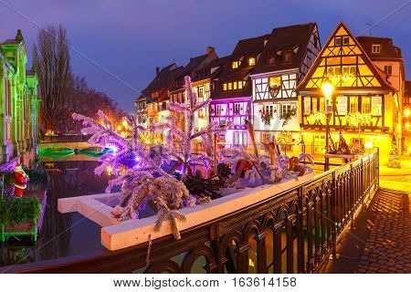 Traditional Alsatian half-timbered houses in Petite Venise, old town of Colmar, decorated and illuminated at christmas time, Alsace, France