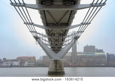 The Millennium bridge in London over the River Thames on a very foggy day