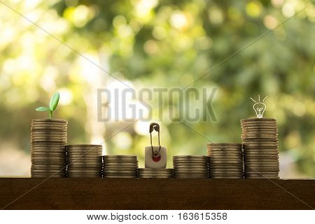 stack of coins ,dice and man sitting on top dice concept idea for business financial or money.