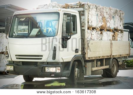 Cardboard stacked on a truck prior to processing at a recycling plant