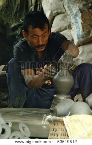 Nepalese Artisan Makes A Clay Pot Modelled With His Hands