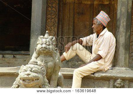 Elderly Man In Durbar Square, Watching Left.