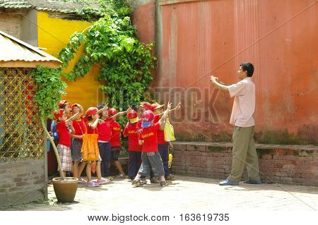 Teacher Takes A Picture Of His Class Of Children.