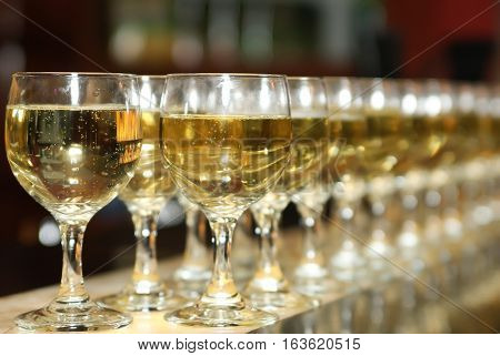 A lot of glasses of alcoholic drink in the bar