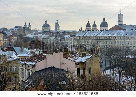 Winter Day in Lviv. View of the central part of the city and churches: St. Michael's Ukrainian Catholic Church Church of the Holy Communion Korniakt Tower Armenian cathedral Transfiguration Church Lviv city council.