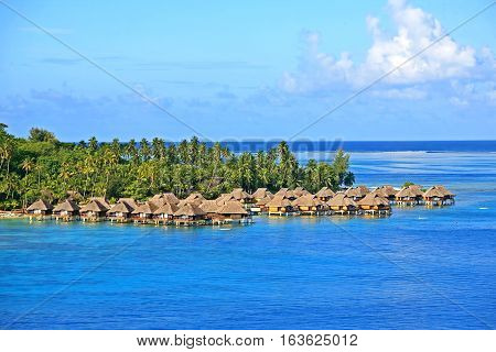Hotel with cabins over water on perimeter island to Bora Bora.