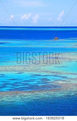 Fishing shack off Raiatea island in Tahiti. Coral bench inside the reef.