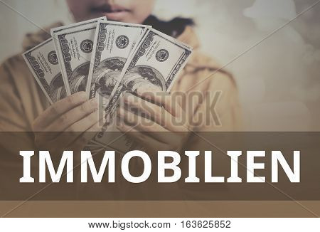 Property (in German) Word Over Young Girl Holding Dollar Bills.