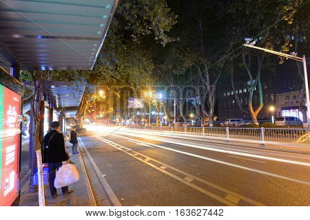 NANJING, CHINA - NOV.1, 2015: Daxinggong bus stop on Zhongshan East Road (Zhongshan Dong Lu) at night in downtown Nanjing, Jiangsu Province, China. This Road is a main road across city of Nanjing.