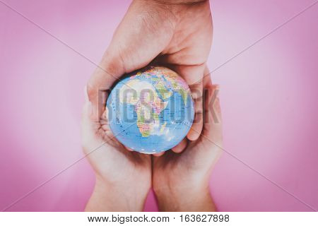 hands holding the world. concept to travel and protect the world