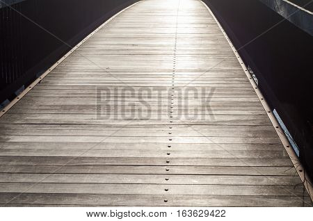 Surface of wooden boards with metal bolts in perspective as background