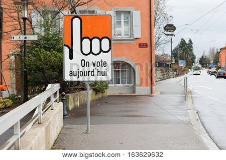 LUTRY, CANTON OF VAUD, SWITZERLAND- SEPTEMBER 14, 2014: Voting sign on the street