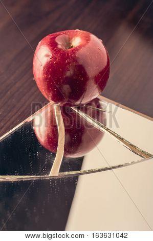 Red Apple On Broken Mirror