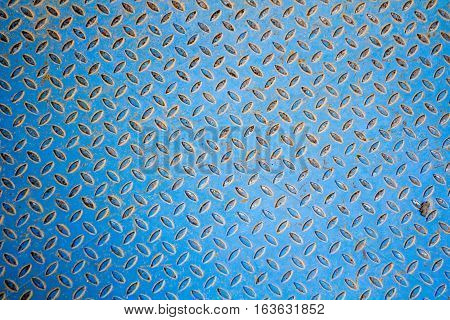 Background of a blue industrial metallic floor with a bumpy pattern