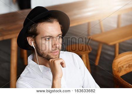 People, Leisure And Technology Concept. Fashionable Young Man With Beard Relaxing Indoors Alone, Day