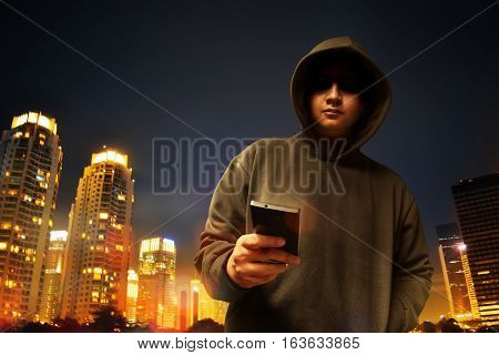 Hacker anonymous in the city at night