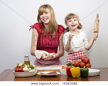Happy sisters making pizza poster