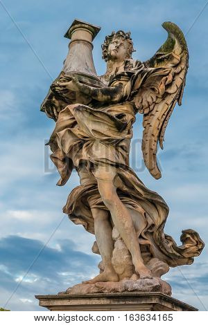 Marble statue of an Angel by famous sculptor Gian Lorenzo Bernini on the Ponte Sant'Angelo Bridge of Angels at the Castel Sant'Angelo in Rome Italy