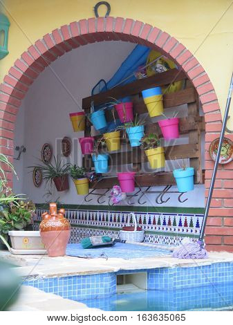 Colorful Flowerpots In Arch