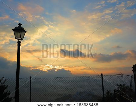 Street Light at orange dawn clouds in Andalusian countryside