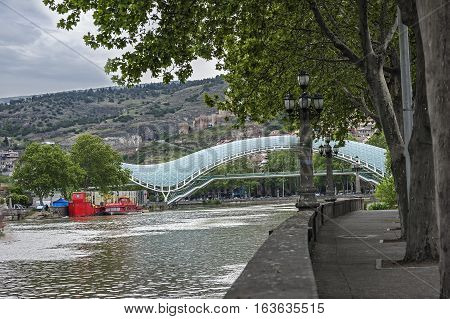 Georgia, Tbilisi.  View from the embankment of the Kura at the Bridge of Peace , Narikala Fortress , Metekhi Cathedral .