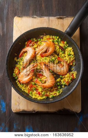 Spanish Paella With Seafood In A Frying Pan. Delicious Lunch On