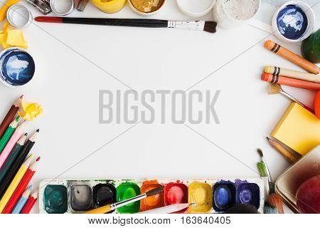 Colorful drawing supplies frame on white background free space, flat lay. Art, workshop, painting, inspiration, craft, creativity concept