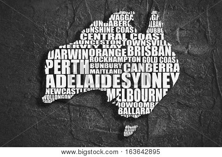 Map of Australia made from cities list. Grunge textured backdrop. Monochrome image