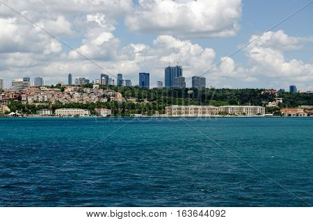 ISTANBUL TURKEY - JUNE 8 2016: Elegant luxury hotels on the Bosphorus shore in the Besiktas district of Istanbul on a Summer day. The Four Seasons hotel and the Ciragan Palace Hotel are both located in former Ottoman Palaces on the water's edge.