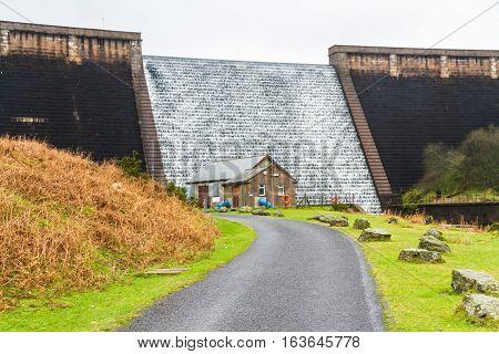 Avon Dam with water flowing down. Dartmoor Devon England United Kingdom.