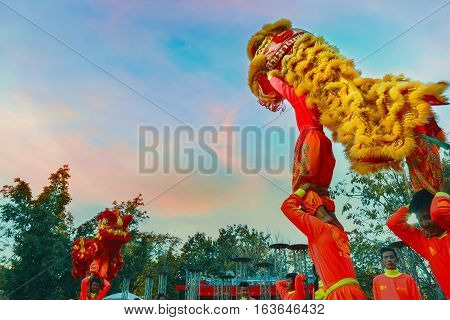 Bangkok, Thailand - January 14 2016: A Group Of People Perform A Lion Dance During Chinese New Year'