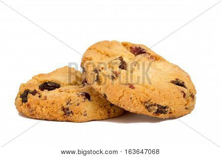Two cookies with raisins isolated over white background
