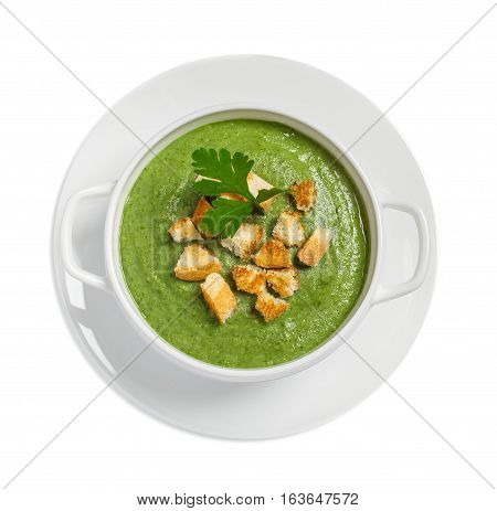 Cream soup with dried crusts isolated on white studio shot