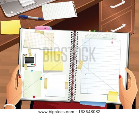 A first person view of a woman holding a personal scrapbook. Plenty of blank space for your own messages.