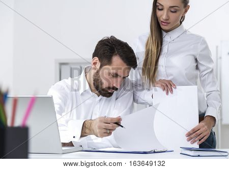 Man Signing Documents Given By Secretary