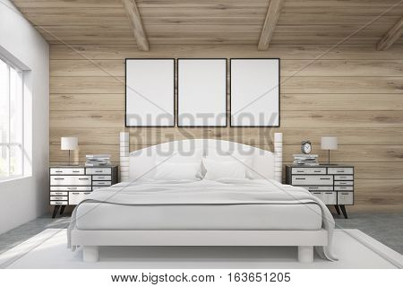 Double Bed In A Wooden Room With Posters