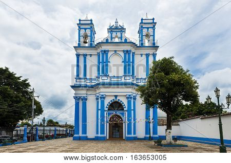 Church painted in blue and white in the city of San Cristobal de Las Casas Chiapas Mexico